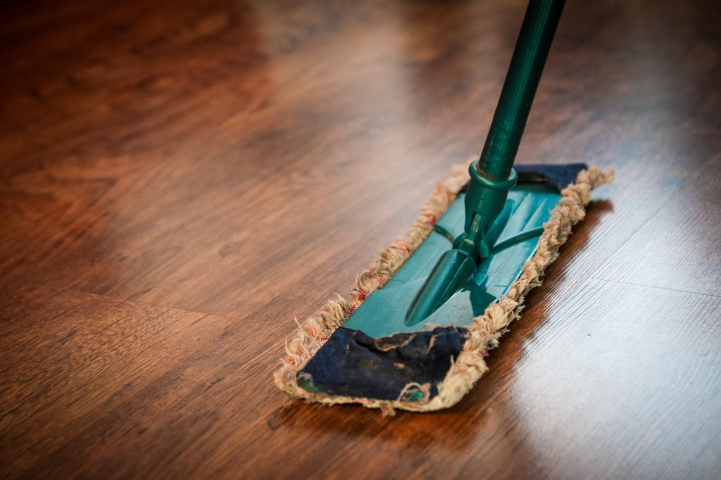 Mop and a Brown Wooden Floor