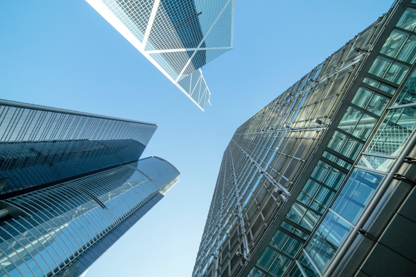 a low angle of spotless glass commercial buildings