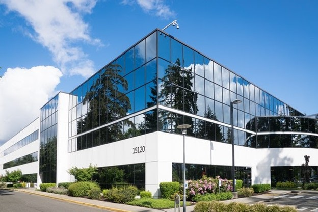 a glass white commercial building on a sunny day